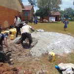 The Water Project: Demesi Primary School -  Preparing Cement For Construction