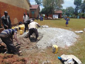 The Water Project:  Preparing Cement For Construction