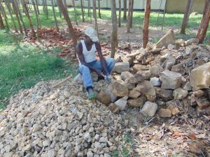 The Water Project:  Breaking Stones Into Gravel