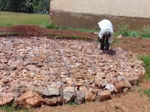The Water Project:  Setting Rain Tank Foundation
