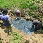 The Water Project: Sambaka Community, Sambaka Spring -  Laying The Foundation