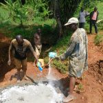 The Water Project: Emulembo Community, Gideon Spring -  Mixing Concrete