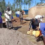 The Water Project: Demesi Primary School -  Pupils Deliver Water To Mix Cement As Dome Work Begins