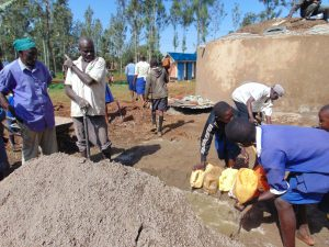 The Water Project:  Pupils Deliver Water To Mix Cement As Dome Work Begins