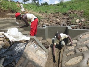 The Water Project:  Shaping The Drainage Channel