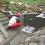 The Water Project: Sambaka Community, Sambaka Spring -  Tile Setting