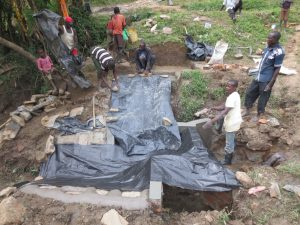 The Water Project:  Covering The New Cement To Dry