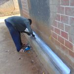 The Water Project: Nanganda Primary School -  Artisan Prepares The Gutter