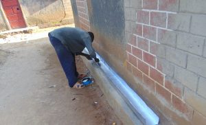 The Water Project:  Artisan Prepares The Gutter
