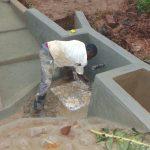 The Water Project: Masuveni Community, Masuveni Spring -  Setting The Tiles