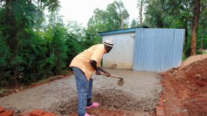 The Water Project:  Laying Concrete Slab For Latrines
