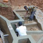 The Water Project: Bumira Community, Madegwa Spring -  Plasteromg Amd Confirming Measurements