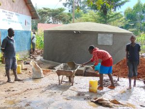 The Water Project:  Students Help Mix Cement