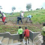 The Water Project: Sambaka Community, Sambaka Spring -  Planting Grass On Spring Box