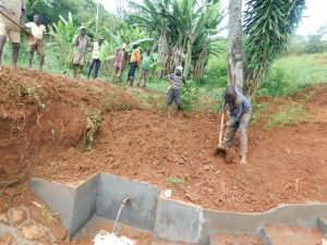 The Water Project:  Filling In Backfilled Area With Soil