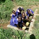 The Water Project: Eshimuli Primary School -  Students Collecting Water At The Spring