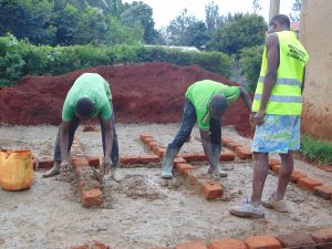The Water Project:  Outlining Latrine Stalls On The Foundation