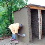 The Water Project: Ebulonga Mixed Secondary School -  Cementing Latrine Wall