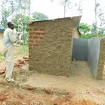 The Water Project: Shichinji Primary School -  Cementing And Plastering Latrines