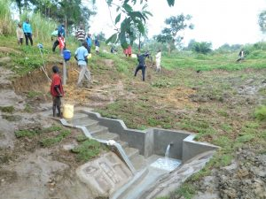 The Water Project:  Community Members Help Level The Surrounding Area