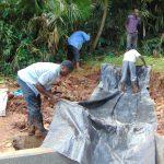 The Water Project: Masuveni Community, Masuveni Spring -  Adding The Tarp Layer