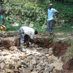 The Water Project: Bumira Community, Madegwa Spring -  Backfilling With Stones Begins