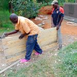 The Water Project: Ebulonga Mixed Secondary School -  Planing The Latrine Doors