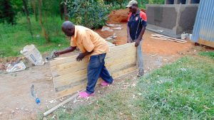 The Water Project:  Planing The Latrine Doors