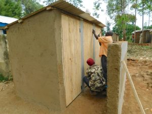 The Water Project:  Latrines Receive Their Doors