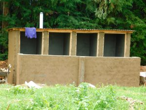 The Water Project:  Latrines Get Roof And Ventilation Pipe
