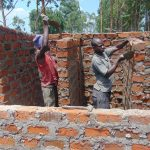 The Water Project: Nanganda Primary School -  Latrines Going Up Brick By Brick