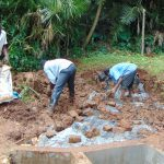 The Water Project: Masuveni Community, Masuveni Spring -  Covering Tarp With Soil