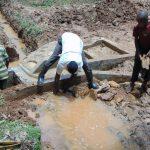 The Water Project: Bumira Community, Madegwa Spring -  Backfilling