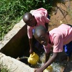 The Water Project: Eshimuli Primary School -  Students Collecting Water