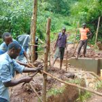The Water Project: Masuveni Community, Masuveni Spring -  Building Fence Around Spring