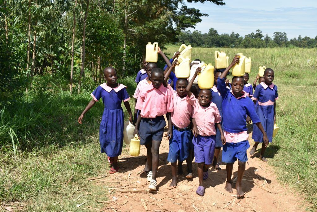 The Water Project : 18-kenya20006-students-carry-water-back-to-school-1