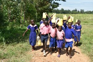 The Water Project:  Students Carry Water Back To School
