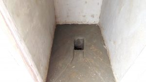 The Water Project:  Well Positioned Squat Hole Inside A New Latrine