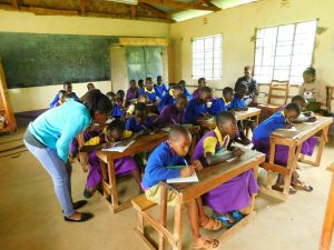 The Water Project:  Students Take Notes During Training