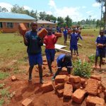 The Water Project: Demesi Primary School -  Students Deliver Bricks For Construction