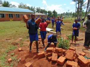 The Water Project:  Students Deliver Bricks For Construction