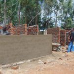 The Water Project: Nanganda Primary School -  Cementing Latrines
