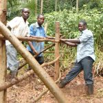 The Water Project: Masuveni Community, Masuveni Spring -  Adjusting The Fence