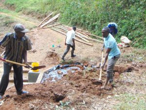The Water Project:  Addin Soil To Backfill