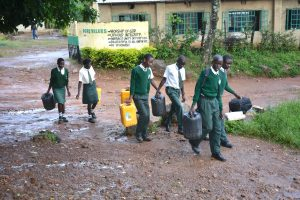 The Water Project:  Students Carrying Water