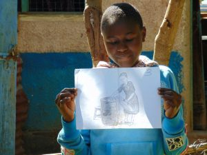 The Water Project:  Student Holds Training Materials