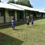 The Water Project: Eshimuli Primary School -  Students Play Outside Classrooms