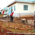 The Water Project: Ebulonga Mixed Secondary School -  Laying Rain Tank Foundation