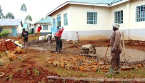 The Water Project:  Laying Rain Tank Foundation