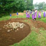 The Water Project: Kapkures Primary School -  Pupils Help Deliver Stones For Rain Tank Foundation